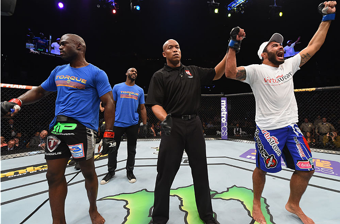 LAS VEGAS, NV - MAY 23:  Rafael Natal of Brazil (right) reacts to his victory over Uriah Hall (left) in their middleweight bout during the UFC 187 event at the MGM Grand Garden Arena on May 23, 2015 in Las Vegas, Nevada.  (Photo by Josh Hedges/Zuffa LLC/Z