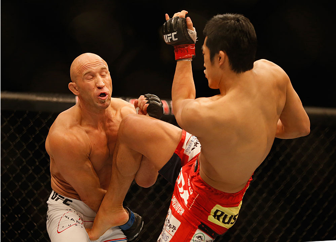 LAS VEGAS, NV - MAY 23:  (R-L) Dong Hyun Kim kicks Josh Burkman in their welterweight bout during the UFC 187 event at the MGM Grand Garden Arena on May 23, 2015 in Las Vegas, Nevada.  (Photo by Christian Petersen/Zuffa LLC/Zuffa LLC via Getty Images)