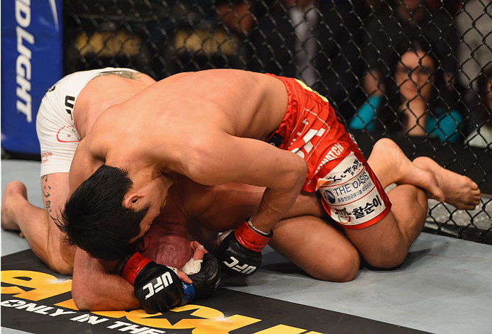 LAS VEGAS, NV - MAY 23:  Dong Hyun Kim (top) punches Josh Burkman in their welterweight bout during the UFC 187 event at the MGM Grand Garden Arena on May 23, 2015 in Las Vegas, Nevada.  (Photo by Josh Hedges/Zuffa LLC/Zuffa LLC via Getty Images)