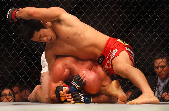 LAS VEGAS, NV - MAY 23:  Dong Hyun Kim  (top) punches Josh Burkman in their welterweight bout during the UFC 187 event at the MGM Grand Garden Arena on May 23, 2015 in Las Vegas, Nevada.  (Photo by Christian Petersen/Zuffa LLC/Zuffa LLC via Getty Images)