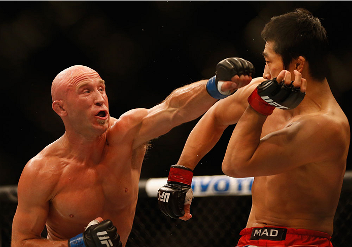 LAS VEGAS, NV - MAY 23:  (L-R) Josh Burkman punches Dong Hyun Kim in their welterweight bout during the UFC 187 event at the MGM Grand Garden Arena on May 23, 2015 in Las Vegas, Nevada.  (Photo by Christian Petersen/Zuffa LLC/Zuffa LLC via Getty Images)