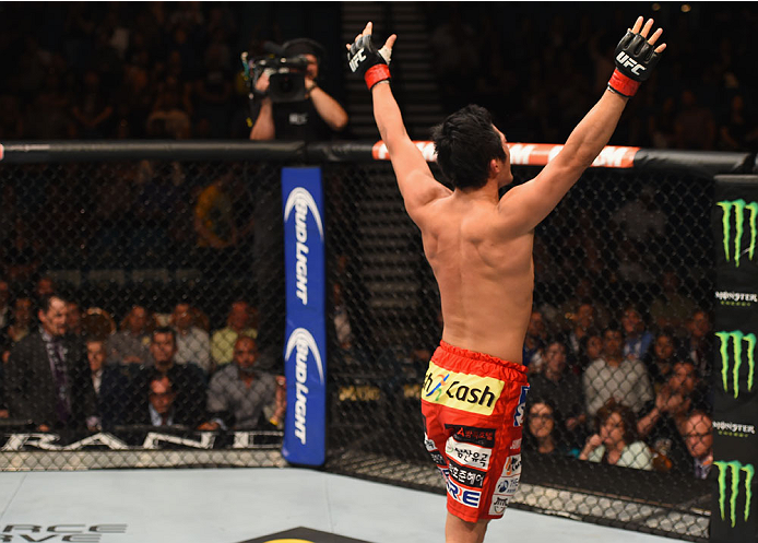 LAS VEGAS, NV - MAY 23:  Dong Hyun Kim reacts to his victory over Josh Burkman in their welterweight bout during the UFC 187 event at the MGM Grand Garden Arena on May 23, 2015 in Las Vegas, Nevada.  (Photo by Josh Hedges/Zuffa LLC/Zuffa LLC via Getty Ima