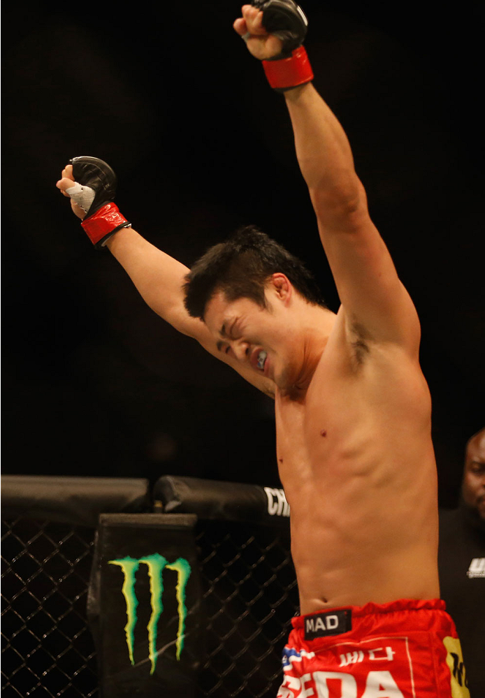 LAS VEGAS, NV - MAY 23:  (L-R) Dong Hyun Kim reacts to his victory over Josh Burkman in their welterweight bout during the UFC 187 event at the MGM Grand Garden Arena on May 23, 2015 in Las Vegas, Nevada.  (Photo by Christian Petersen/Zuffa LLC/Zuffa LLC