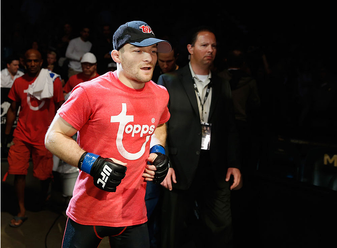 LAS VEGAS, NV - MAY 23:  Zach Makovsky runs to the Octagon to face John Dodson in their flyweight bout during the UFC 187 event at the MGM Grand Garden Arena on May 23, 2015 in Las Vegas, Nevada.  (Photo by Christian Petersen/Zuffa LLC/Zuffa LLC via Getty