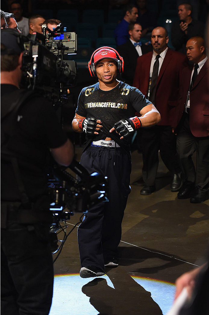 LAS VEGAS, NV - MAY 23:  John Dodson walks to the Octagon to face Zach Makovsky  in their flyweight bout during the UFC 187 event at the MGM Grand Garden Arena on May 23, 2015 in Las Vegas, Nevada.  (Photo by Josh Hedges/Zuffa LLC/Zuffa LLC via Getty Imag