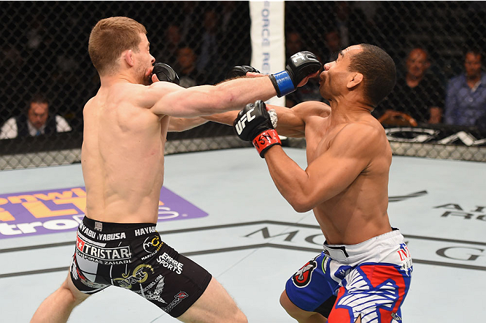 LAS VEGAS, NV - MAY 23:  (L-R) Zach Makovsky and John Dodson exchange punches in their flyweight bout during the UFC 187 event at the MGM Grand Garden Arena on May 23, 2015 in Las Vegas, Nevada.  (Photo by Josh Hedges/Zuffa LLC/Zuffa LLC via Getty Images)