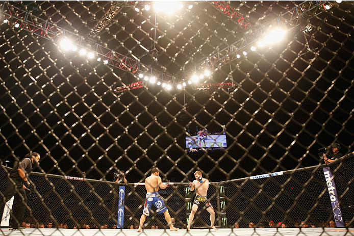 LAS VEGAS, NV - MAY 23:  (L-R) John Dodson and Zach Makovsky face off in their flyweight bout during the UFC 187 event at the MGM Grand Garden Arena on May 23, 2015 in Las Vegas, Nevada.  (Photo by Christian Petersen/Zuffa LLC/Zuffa LLC via Getty Images)