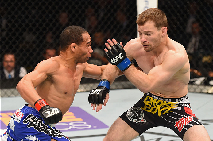 LAS VEGAS, NV - MAY 23:  (L-R) John Dodson punches Zach Makovsky in their flyweight bout during the UFC 187 event at the MGM Grand Garden Arena on May 23, 2015 in Las Vegas, Nevada.  (Photo by Josh Hedges/Zuffa LLC/Zuffa LLC via Getty Images)