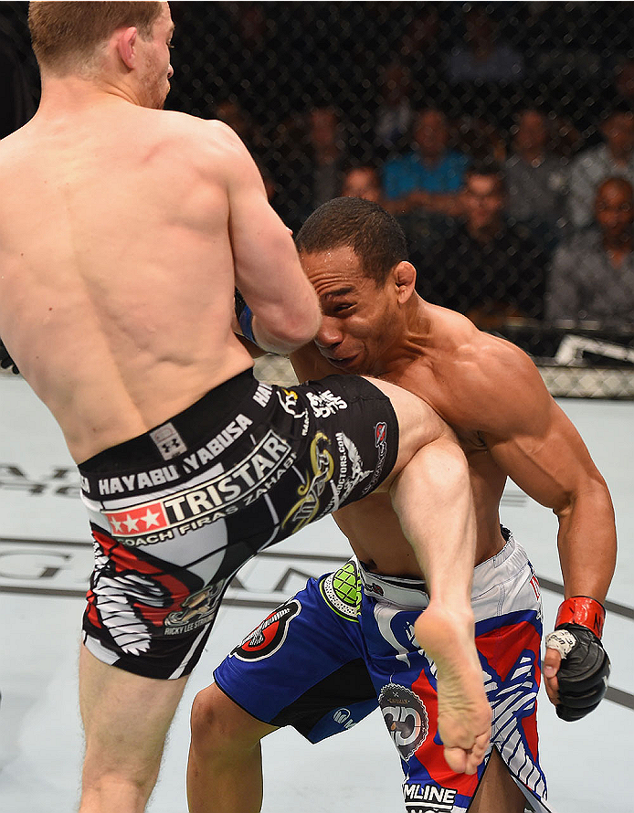 LAS VEGAS, NV - MAY 23:  (L-R) Zach Makovsky knees John Dodson in their flyweight bout during the UFC 187 event at the MGM Grand Garden Arena on May 23, 2015 in Las Vegas, Nevada.  (Photo by Josh Hedges/Zuffa LLC/Zuffa LLC via Getty Images)
