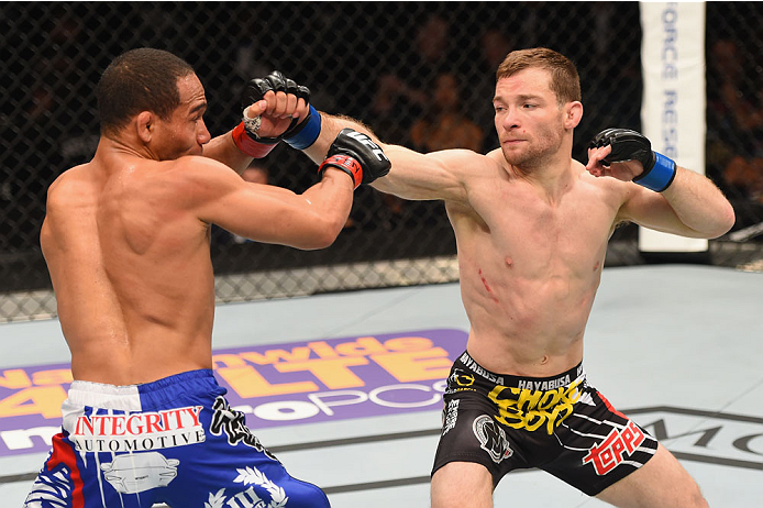 LAS VEGAS, NV - MAY 23:  (R-L) Zach Makovsky punches John Dodson in their flyweight bout during the UFC 187 event at the MGM Grand Garden Arena on May 23, 2015 in Las Vegas, Nevada.  (Photo by Josh Hedges/Zuffa LLC/Zuffa LLC via Getty Images)