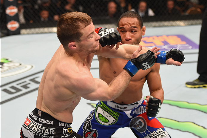 LAS VEGAS, NV - MAY 23:  (R-L) John Dodson punches Zach Makovsky in their flyweight bout during the UFC 187 event at the MGM Grand Garden Arena on May 23, 2015 in Las Vegas, Nevada.  (Photo by Josh Hedges/Zuffa LLC/Zuffa LLC via Getty Images)