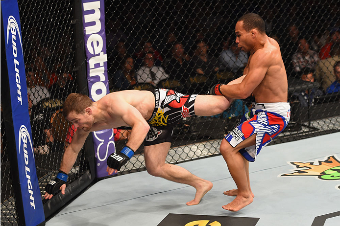 LAS VEGAS, NV - MAY 23:  (R-L) John Dodson attempts to take down Zach Makovsky in their flyweight bout during the UFC 187 event at the MGM Grand Garden Arena on May 23, 2015 in Las Vegas, Nevada.  (Photo by Josh Hedges/Zuffa LLC/Zuffa LLC via Getty Images