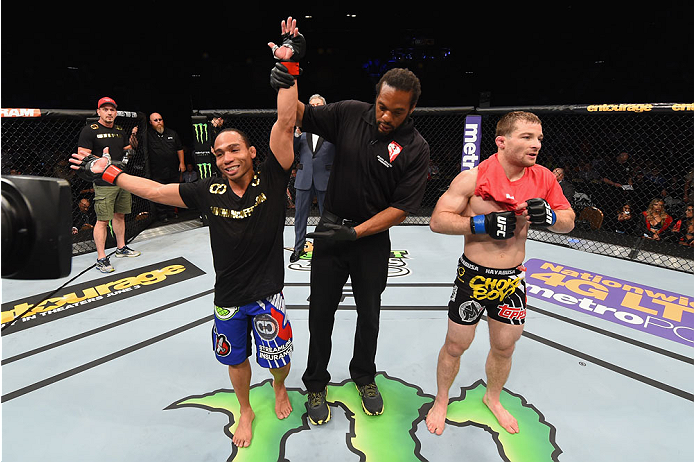 LAS VEGAS, NV - MAY 23:  John Dodson (left) reacts to his victory over Zach Makovsky (right) in their flyweight bout during the UFC 187 event at the MGM Grand Garden Arena on May 23, 2015 in Las Vegas, Nevada.  (Photo by Josh Hedges/Zuffa LLC/Zuffa LLC vi