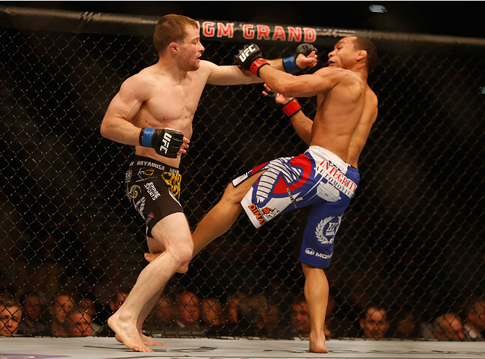 LAS VEGAS, NV - MAY 23:  (L-R) Zach Makovsky punches John Dodson in their flyweight bout during the UFC 187 event at the MGM Grand Garden Arena on May 23, 2015 in Las Vegas, Nevada.  (Photo by Christian Petersen/Zuffa LLC/Zuffa LLC via Getty Images)