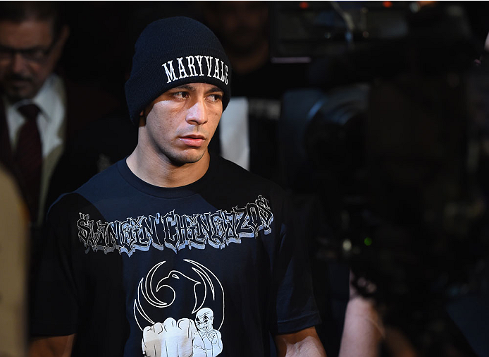 LAS VEGAS, NV - MAY 23:  John Moraga walks to the Octagon to face Joseph Benavidez in their flyweight bout during the UFC 187 event at the MGM Grand Garden Arena on May 23, 2015 in Las Vegas, Nevada.  (Photo by Josh Hedges/Zuffa LLC/Zuffa LLC via Getty Im