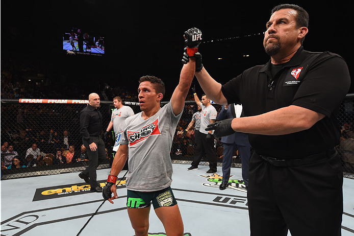 LAS VEGAS, NV - MAY 23:  Joseph Benavidez reacts to his victory over John Moraga in their flyweight bout during the UFC 187 event at the MGM Grand Garden Arena on May 23, 2015 in Las Vegas, Nevada.  (Photo by Josh Hedges/Zuffa LLC/Zuffa LLC via Getty Imag