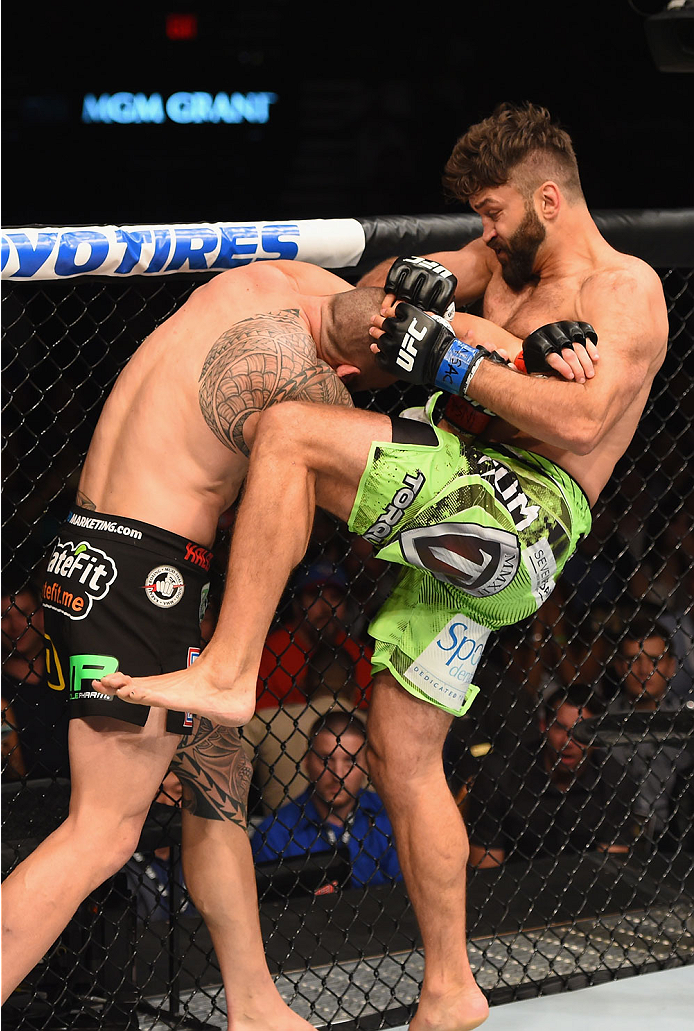 LAS VEGAS, NV - MAY 23:  (R-L) Andrei Arlovski knees Travis Browne in their heavyweight bout during the UFC 187 event at the MGM Grand Garden Arena on May 23, 2015 in Las Vegas, Nevada.  (Photo by Josh Hedges/Zuffa LLC/Zuffa LLC via Getty Images)