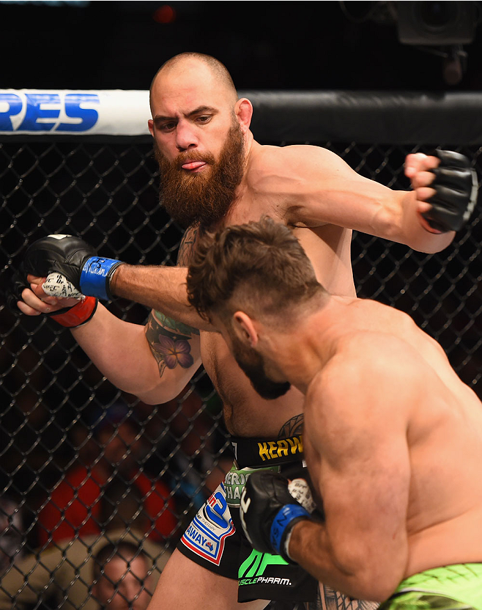 LAS VEGAS, NV - MAY 23:  Travis Browne (top) and Andrei Arlovski (bottom) exchange punches in their heavyweight bout during the UFC 187 event at the MGM Grand Garden Arena on May 23, 2015 in Las Vegas, Nevada.  (Photo by Josh Hedges/Zuffa LLC/Zuffa LLC vi