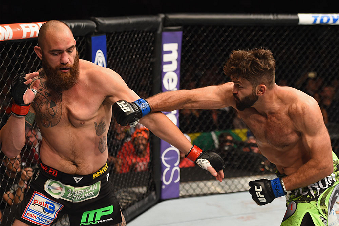 LAS VEGAS, NV - MAY 23:  (R-L) Andrei Arlovski punches Travis Browne in their heavyweight bout during the UFC 187 event at the MGM Grand Garden Arena on May 23, 2015 in Las Vegas, Nevada.  (Photo by Josh Hedges/Zuffa LLC/Zuffa LLC via Getty Images)