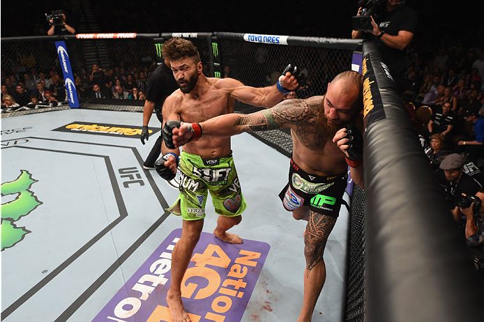 LAS VEGAS, NV - MAY 23:  (L-R) Andrei Arlovski and Travis Browne exchange punches in their heavyweight bout during the UFC 187 event at the MGM Grand Garden Arena on May 23, 2015 in Las Vegas, Nevada.  (Photo by Josh Hedges/Zuffa LLC/Zuffa LLC via Getty I
