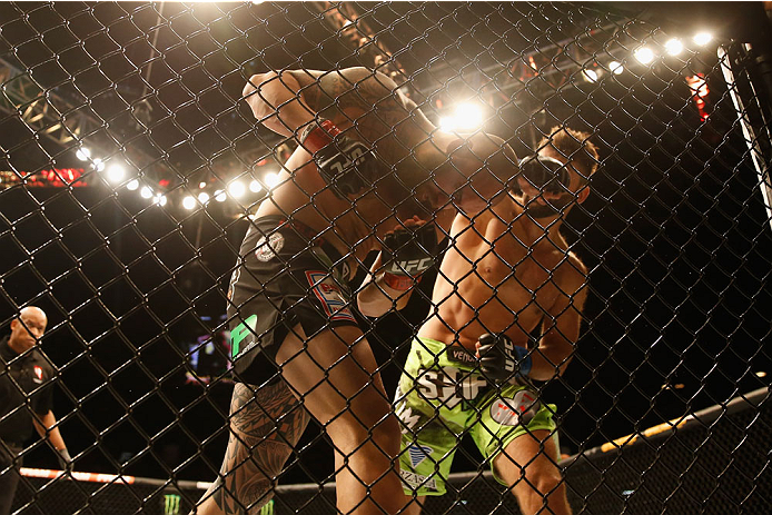 LAS VEGAS, NV - MAY 23:  (R-L) Andrei Arlovski punches Travis Browne in their heavyweight bout during the UFC 187 event at the MGM Grand Garden Arena on May 23, 2015 in Las Vegas, Nevada.  (Photo by Christian Petersen/Zuffa LLC/Zuffa LLC via Getty Images)