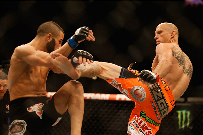 LAS VEGAS, NV - MAY 23:  (R-L) Donald Cerrone kicks John Makdessi of Canada in their lightweight bout during the UFC 187 event at the MGM Grand Garden Arena on May 23, 2015 in Las Vegas, Nevada.  (Photo by Christian Petersen/Zuffa LLC/Zuffa LLC via Getty