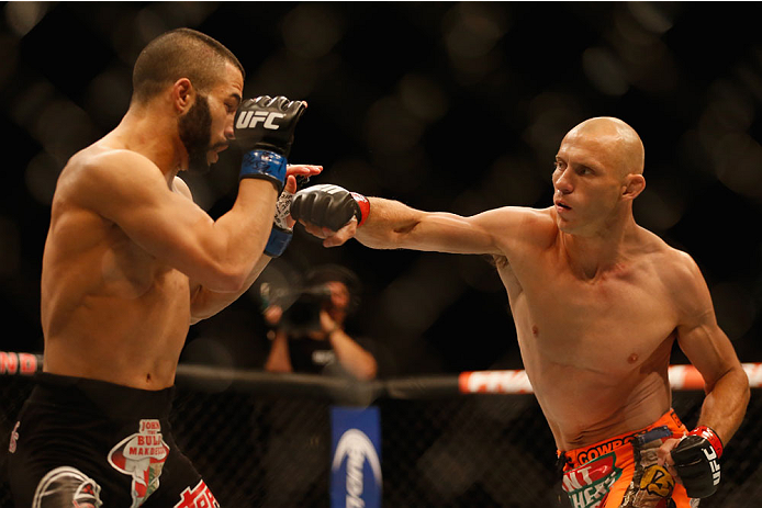 LAS VEGAS, NV - MAY 23:  (R-L) Donald Cerrone punches John Makdessi of Canada in their lightweight bout during the UFC 187 event at the MGM Grand Garden Arena on May 23, 2015 in Las Vegas, Nevada.  (Photo by Christian Petersen/Zuffa LLC/Zuffa LLC via Gett
