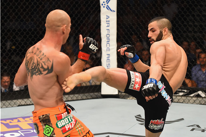 LAS VEGAS, NV - MAY 23:  (R-L) John Makdessi of Canada kicks Donald Cerrone in their lightweight bout during the UFC 187 event at the MGM Grand Garden Arena on May 23, 2015 in Las Vegas, Nevada.  (Photo by Josh Hedges/Zuffa LLC/Zuffa LLC via Getty Images)