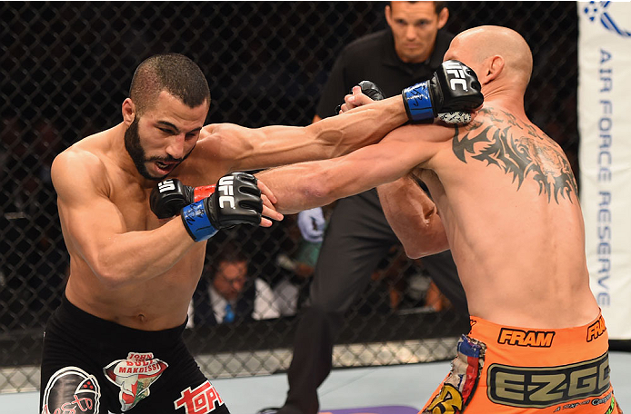 LAS VEGAS, NV - MAY 23:  (L-R) John Makdessi of Canada and Donald Cerrone exchange punches in their lightweight bout during the UFC 187 event at the MGM Grand Garden Arena on May 23, 2015 in Las Vegas, Nevada.  (Photo by Josh Hedges/Zuffa LLC/Zuffa LLC vi