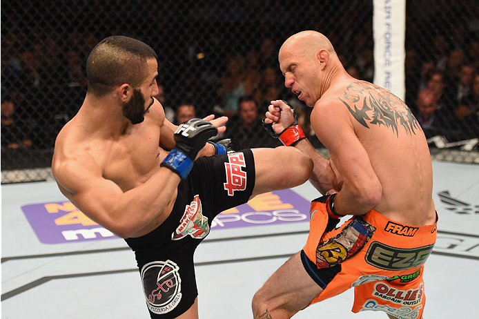 LAS VEGAS, NV - MAY 23:  (L-R) John Makdessi of Canada kicks Donald Cerrone in their lightweight bout during the UFC 187 event at the MGM Grand Garden Arena on May 23, 2015 in Las Vegas, Nevada.  (Photo by Josh Hedges/Zuffa LLC/Zuffa LLC via Getty Images)