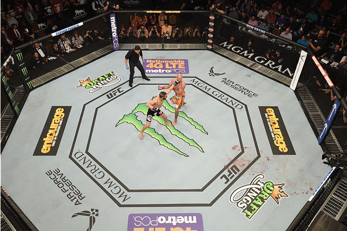 LAS VEGAS, NV - MAY 23:  (L-R) John Makdessi of Canada punches Donald Cerrone in their lightweight bout during the UFC 187 event at the MGM Grand Garden Arena on May 23, 2015 in Las Vegas, Nevada.  (Photo by Josh Hedges/Zuffa LLC/Zuffa LLC via Getty Image