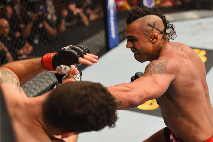 LAS VEGAS, NV - MAY 23:  (R-L) Vitor Belfort of Brazil punches Chris Weidman in their UFC middleweight championship bout during the UFC 187 event at the MGM Grand Garden Arena on May 23, 2015 in Las Vegas, Nevada.  (Photo by Josh Hedges/Zuffa LLC/Zuffa LL