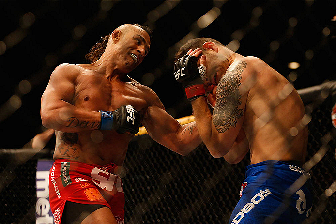 LAS VEGAS, NV - MAY 23:  (L-R) Vitor Belfort of Brazil punches Chris Weidman in their UFC middleweight championship bout during the UFC 187 event at the MGM Grand Garden Arena on May 23, 2015 in Las Vegas, Nevada.  (Photo by Christian Petersen/Zuffa LLC/Z