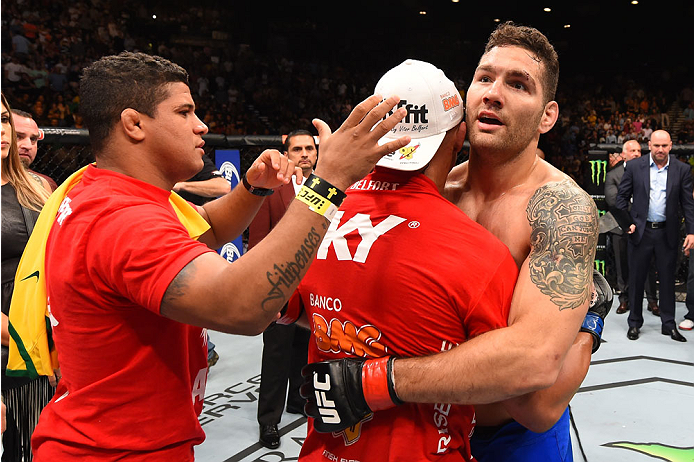 LAS VEGAS, NV - MAY 23:  (R-L) Chris Weidman and Vitor Belfort of Brazil embrace after their UFC middleweight championship bout during the UFC 187 event at the MGM Grand Garden Arena on May 23, 2015 in Las Vegas, Nevada.  (Photo by Josh Hedges/Zuffa LLC/Z
