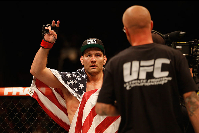 LAS VEGAS, NV - MAY 23:  Chris Weidman reacts to his victory over Vitor Belfort of Brazil in their UFC middleweight championship bout during the UFC 187 event at the MGM Grand Garden Arena on May 23, 2015 in Las Vegas, Nevada.  (Photo by Christian Peterse