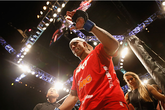 LAS VEGAS, NV - MAY 23:  Vitor Belfort of Brazil exits the Octagon after his loss to Chris Weidman their UFC middleweight championship bout during the UFC 187 event at the MGM Grand Garden Arena on May 23, 2015 in Las Vegas, Nevada.  (Photo by Christian P