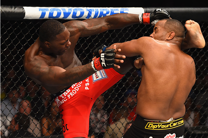 LAS VEGAS, NV - MAY 23:  (L-R) Anthony Johnson kicks Daniel Cormier in their UFC light heavyweight championship bout during the UFC 187 event at the MGM Grand Garden Arena on May 23, 2015 in Las Vegas, Nevada.  (Photo by Josh Hedges/Zuffa LLC/Zuffa LLC vi