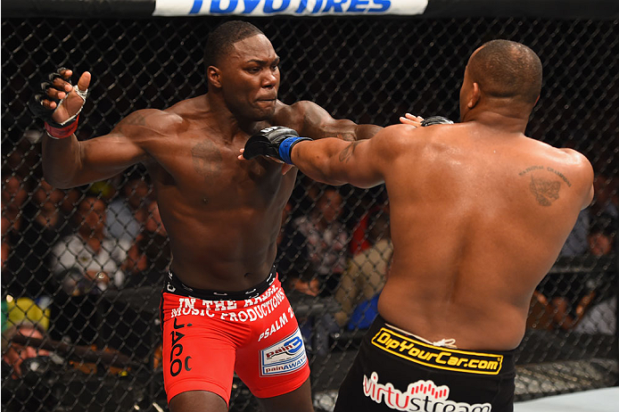 LAS VEGAS, NV - MAY 23:  (L-R) Anthony Johnson punches Daniel Cormier in their UFC light heavyweight championship bout during the UFC 187 event at the MGM Grand Garden Arena on May 23, 2015 in Las Vegas, Nevada.  (Photo by Josh Hedges/Zuffa LLC/Zuffa LLC