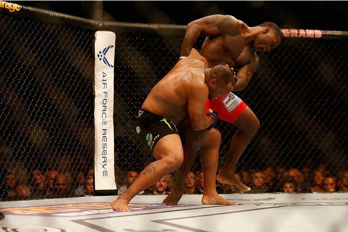 LAS VEGAS, NV - MAY 23:  (L-R) Daniel Cormier attempts to take down Anthony Johnson in their UFC light heavyweight championship bout during the UFC 187 event at the MGM Grand Garden Arena on May 23, 2015 in Las Vegas, Nevada.  (Photo by Christian Petersen