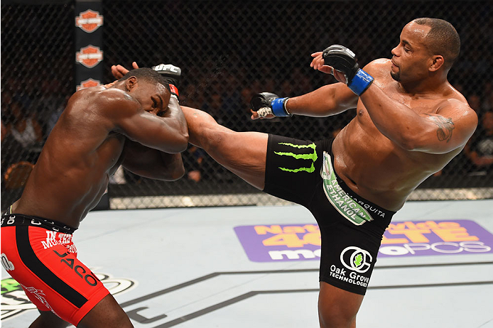 LAS VEGAS, NV - MAY 23:  (R-L) Daniel Cormier kicks Anthony Johnson in their UFC light heavyweight championship bout during the UFC 187 event at the MGM Grand Garden Arena on May 23, 2015 in Las Vegas, Nevada.  (Photo by Josh Hedges/Zuffa LLC/Zuffa LLC vi