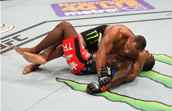 LAS VEGAS, NV - MAY 23:  Daniel Cormier (top) attempts to submit Anthony Johnson in their UFC light heavyweight championship bout during the UFC 187 event at the MGM Grand Garden Arena on May 23, 2015 in Las Vegas, Nevada.  (Photo by Josh Hedges/Zuffa LLC