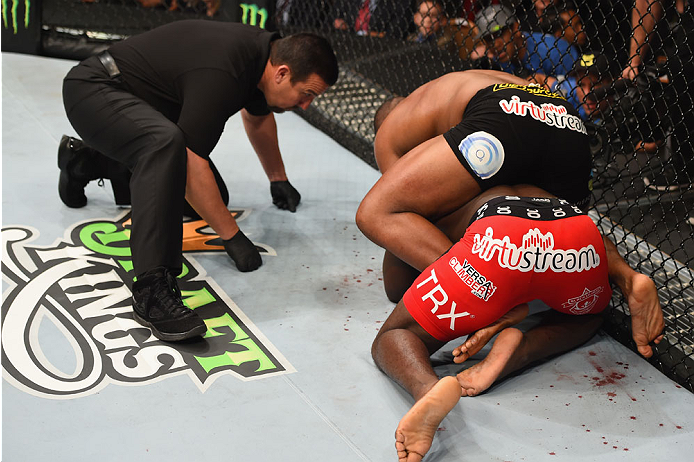 LAS VEGAS, NV - MAY 23:  Daniel Cormier (black shorts) attempts to submit Anthony Johnson (red shorts) in their UFC light heavyweight championship bout during the UFC 187 event at the MGM Grand Garden Arena on May 23, 2015 in Las Vegas, Nevada.  (Photo by