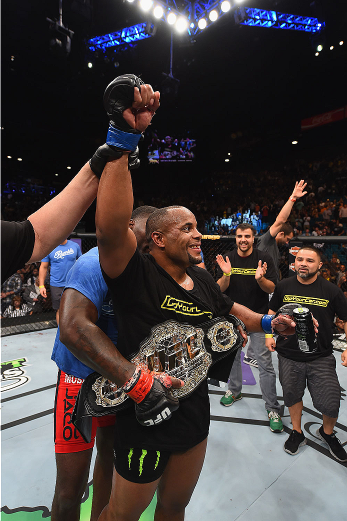 LAS VEGAS, NV - MAY 23:  Daniel Cormier reacts to his victory over Anthony Johnson in their UFC light heavyweight championship bout during the UFC 187 event at the MGM Grand Garden Arena on May 23, 2015 in Las Vegas, Nevada.  (Photo by Josh Hedges/Zuffa L