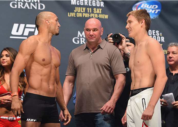 LAS VEGAS, NV - JULY 10:  (L-R) Yosdenis Cedeno and Cody Pfister face off during the UFC 189 weigh-in inside MGM Grand Garden Arena on July 10, 2015 in Las Vegas, Nevada.  (Photo by Josh Hedges/Zuffa LLC/Zuffa LLC via Getty Images)