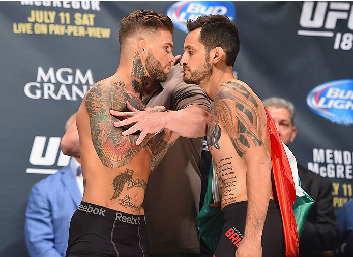 LAS VEGAS, NV - JULY 10:  (L-R) Cody Garbrandt and Henry Briones face off during the UFC 189 weigh-in inside MGM Grand Garden Arena on July 10, 2015 in Las Vegas, Nevada.  (Photo by Josh Hedges/Zuffa LLC/Zuffa LLC via Getty Images)