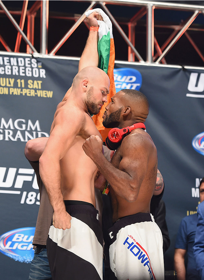 LAS VEGAS, NV - JULY 10:  (L-R) Cathal Pendred and John Howard face off during the UFC 189 weigh-in inside MGM Grand Garden Arena on July 10, 2015 in Las Vegas, Nevada.  (Photo by Josh Hedges/Zuffa LLC/Zuffa LLC via Getty Images)