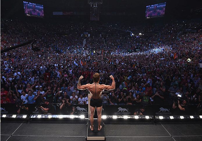 LAS VEGAS, NV - JULY 10:  Conor McGregor steps onto the scale during the UFC 189 weigh-in inside MGM Grand Garden Arena on July 10, 2015 in Las Vegas, Nevada.  (Photo by Zuffa LLC/Zuffa LLC via Getty Images)