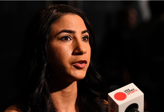 LAS VEGAS, NV - DECEMBER 09:  Tecia Torres interacts with media during the UFC Ultimate Media Day at MGM Grand Hotel & Casino on December 9, 2015 in Las Vegas, Nevada.  (Photo by Josh Hedges/Zuffa LLC/Zuffa LLC via Getty Images)