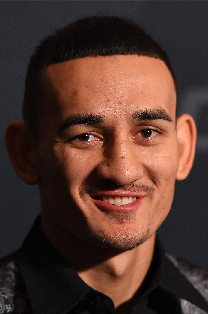 LAS VEGAS, NV - DECEMBER 09:  Max Holloway interacts with media during the UFC Ultimate Media Day at MGM Grand Hotel & Casino on December 9, 2015 in Las Vegas, Nevada.  (Photo by Josh Hedges/Zuffa LLC/Zuffa LLC via Getty Images)