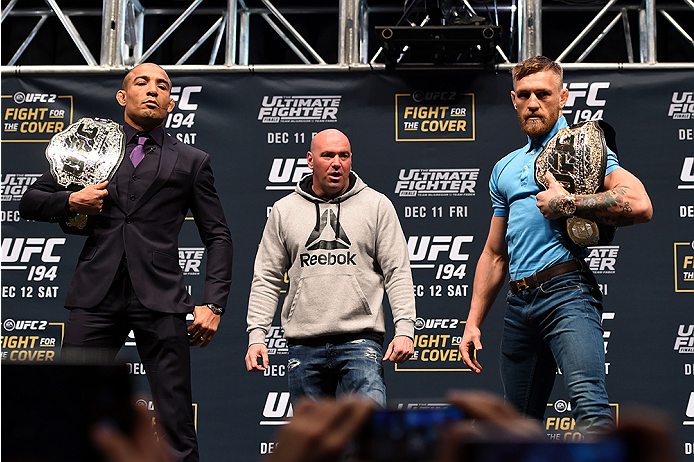 LAS VEGAS, NV - DECEMBER 09:  (L-R) Opponents Jose Aldo of Brazil and Conor McGregor of Ireland pose for photos during the UFC Press Conference inside MGM Grand Garden Arena on December 9, 2015 in Las Vegas, Nevada.  (Photo by Josh Hedges/Zuffa LLC/Zuffa